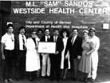 "Sandos family in front of the M.L. ""Sam"" Sandos West Side Health Center"