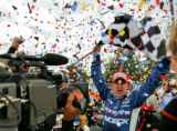 Champ Car World Series driver and Thornton resident A.J. Allmendinger is showered with confetti as...