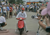 Film star and Champ Car World series owner of Newman Hass Racing, Paul Newman, makes his way to...