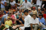 Tom Lehman acknowledges the crowd as he walks back toward the 18th hole teebox to start the first...