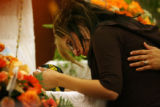 Chanell Trujillo(cq) looks into the face of her son Deion Santistevan, 5, as he lays in a casket...