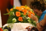 Barbara Mora(cq), of Denver is overcome with emotion upons seeing her great-grand child, Deion...