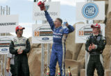 Champ Car World Series driver and Thornton resident A.J. Allmendinger takes the podium joined by...
