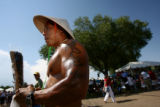 Pao Vue(cq), of North Glenn, uses tanning lotion to take advantage of the summer rays at the 6th...