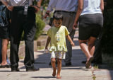 KAS0113 Yazmine Ocana, 3, walks away from where Denver police detectives are speaking with her...