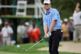 Zach Johnson chips on to the 18th green during final round play at The International Sunday August...