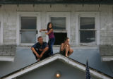 MJM976  Lane Kroschel (cq), 21, left, sits on a roof and takes in the 15th annual Olathe Sweet...