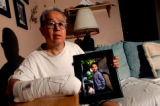Denver, Colo., photo taken June 21, 2004- Leonard Rivera sits in his Aurora home and holds up a...
