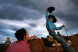 MJM402  Samuel Munoz (cq), 14, left,  tries to get his cowboy hat back as it is playfully taken by...