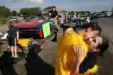 MJM830   Kaylie Hale (cq), 16, right, hugs her boyfriend, Charlie Nutter (cq), 17, before the 15th...