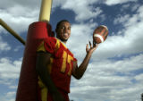 Northglenn High School's football team quarterback Anthony Perkins gets ready for his final...