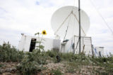 The satellite location exterior. Rita Roberts, (R.E.F.R.A.C.T.T.),  Project Scientist, conducts a...