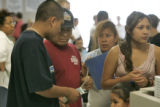 (L-R) Jose Pachican 15, talks with his father Jose, Maria (mother) Jessica 12, and Eileen and ...