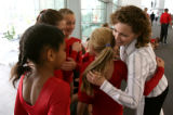 Two-time Olympian Shannon Miller, right, meets members of 5280 Gymnastics Tuesday afternoon August...