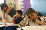 Fifth-grader Cinthia Del Real-Torrez works out a math problem in teacher Christine Houseworth's...