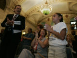 Halley Lind (cq) (r) 10, of Monaco Elementary, in Commerce City was recognized along with teachers...