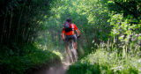 M.O. Alford (cq), 35, of Nederland rides down a trail named Aspen Alley in the West Magnolia Trail...
