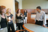 John Temple, right,  president, editor, and publisher of the Rocky Mountain News gives a tour of...