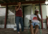 In rural Hamilton, Ala.,on Friday August 18, 2006 sitting on Jeff Brown's (cq) (l) porch Gary...
