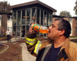 WIRAC104 - Mark Villalpando takes a drink after helping recover the bodies of two people found...