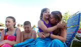 (DENVER, CO., JULY 6, 2004)  From left, Tatiana Ives, 13, bother Samson Ives, 10, talk about...