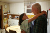 Susan Howerter, cq, left, says goodbye to neighbor Martin Brezonick, cq, 86, in his Somerset,...