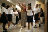 Candice Green, sixth-grade teacher directs students at Farrell Howell Elementary, 14250 E. Albrook...
