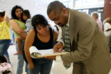 Principal of Florida Pitt Waller Elementary School, 21601 E. 51st Pl., Damon Smith, helps Marci...