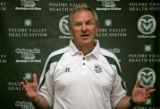 Colorado State University head coach Sonny Lubick answers questions during the 2006 Colorado State...