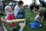 MJM1469  Relaxing on the grass and being entertained by an Elvis impersonator, Madison Randolph,...
