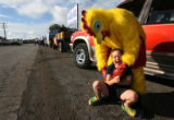 MJM801  Dressed in his Thunder Mountain Speedway Chicken costume, Charlie Nutter (cq), 17, tickles...