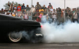 MJM924  A crowd cheers on a participant in the Show Off Your Power Burnout contest Friday evening...