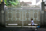 Students leave the Bangkok Christian Academy at the end of their school day on Tuesday, August 22,...