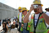 MJM281   Southeast Corridor Constructors employee, Jim Stenger (cq), right, takes a photo of the...