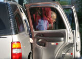 Colorado gubernatorial candidate Bob Beauprez(cq), exits his vehicle at the YMCA in Arvada Tuesday...