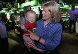 Peggy Lamm (cq) holds Jack Hughes, CQ, 7mo., who began to cry as the media swarmed around Lamm...