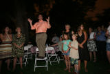 Chris Romer stands on a chair and thanks his family, friends, staff and supporters moments after...