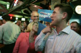 Joe Beauprez (cq) (r) jokes with his father Bob and mom Claudia about the very large, vote for Bob...