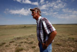 John Davidson(cq) looks out over his family's ranch-land in south of Las Animas Wednesday Aug. 3,...