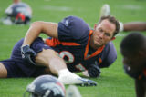 Free agent wide receiver David Kircus (#87) stretches with teammates during Broncos practice...