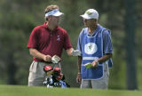 (((((((EDITORS NOTE: FOR SATURDAY STORY ABOUT CADDIES))))))Mathias Gronberg confers with his...