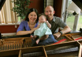 Composer Daniel Kellogg (cq), right, with his concert pianist wife, Hsing-ay Hsu (cq) and their 7...