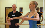 Choreographer Robert Sher-Machherndl (cq) watches dancer Holly Norton (cq) while working on a...