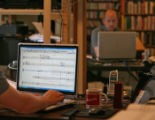 Composer Daniel Kellogg (cq) uses a computer to work on a musical piece from his home, 3085...