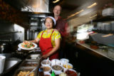 Spotlight food.  Husband and wife, Larry and Toi Newman (cq) pose in thier Boulder restaurant Khow...