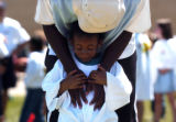 (Aurora, Colo.  July 7, 2004)   Alijah McLamb, 5, of Aurora is comforted by volunteer Tony...