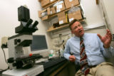 Associate Professor of Medicine Chris Hogan discusses stem cell research with the media at a lab...