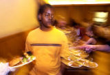 (DENVER, Colo., June 7, 2004)  Joseph Thomas, 12, serves food to the needy at Trinity United...