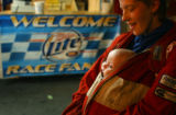 Hampton, Virginia-Crystal Balduf, Newport News, Virginia, warms her daughter Rosa, 7 months, in...