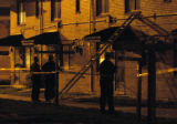 (DENVER, Colo., July 11, 2004)  Police investigate the scene at 1234 W. 10th Ave., Denver, Colo.,...